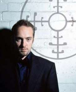 Illusionist Derren Brown, as seen through the crosshair of his mother's rifle