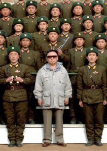 North Korean leader Kim-Jong-Il: Proof, were it needed, that it doesn't matter how many tough army guys are standing around you - if you are wearing a rubbishy old anorak, you still look like a pillock